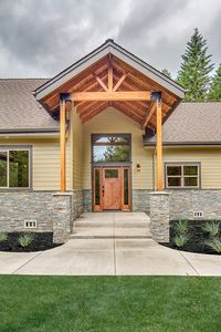 """<ul><li><strong>MORE PHOTOS</strong>: See more photos in our Google+ <a href=""""http://bit.ly/72815da-g"""">photo album</a>.</li><li>Sticks and struts highlight the Craftsman-style front gables in this ranch home plan. Columns and cultured stone frame the vaulted covered porch, creating an inviting entry portico. The slender chimney, too, is clad in cultured stone, and sports an interesting metal cap.<&..."""