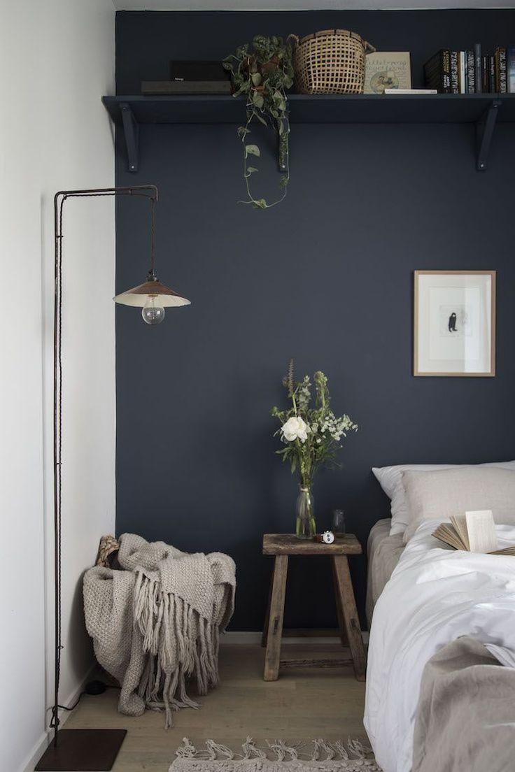 my scandinavian home: small guest bedroom with dark blue walls, linen bedding an