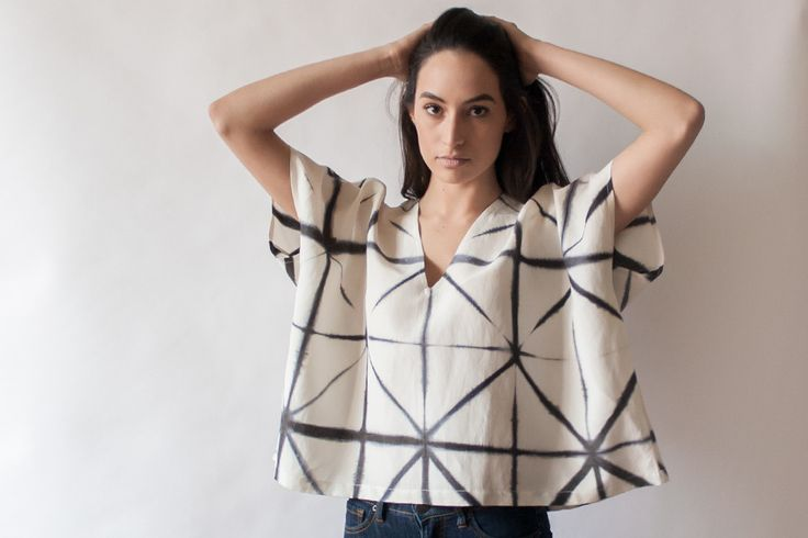 The B+W Lattice Box Top is hand-dyed using Japanese Shibori Itajime to create the black and white lattice pattern. Simple box shape, low v neck with back design detail.