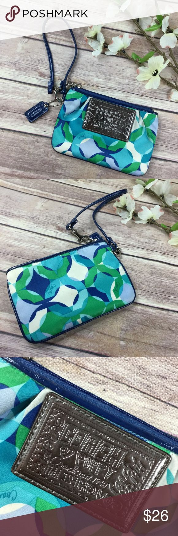 Coach Poppy blue small wristlet Cute little Coach Poppy wristlet. Blue green exterior. Has been used a couple times and has some marks in various spots not very noticeable. Save instantly when bundled with any other item! Coach Bags Clutches & Wristlets
