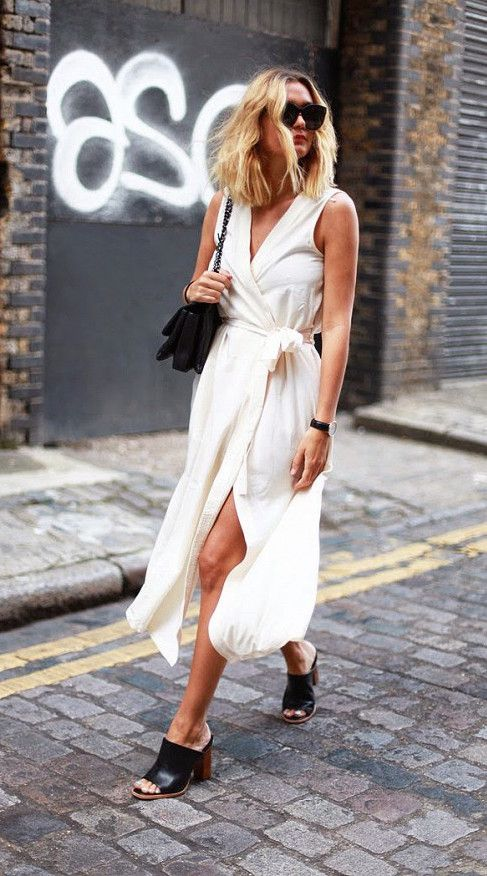 White wrap dress with high slit worn with black mules