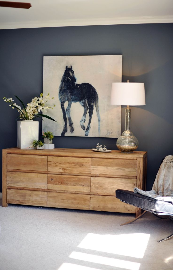 love the wall colour and how its repeated in the painting, also both contrast wonderfully with timber drawers