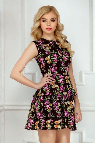 Irina Mohora wearing our mini flowery Capri dress. Check it out here: http://bit.ly/rochita-capri
