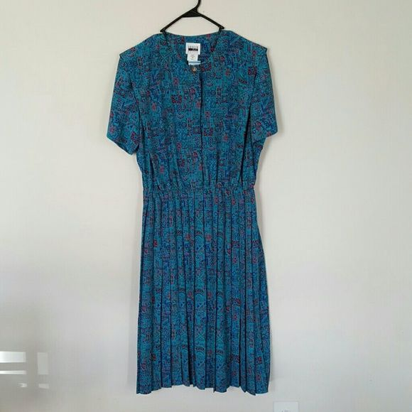 Vintage Aztec Turquoise Never worn vintage dress with pleated bottom and Aztec-like design Leslie Fay Dresses