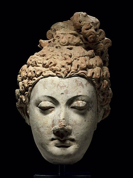 A terracotta head of a bodhisattva ancient Gandhara, 3rd/4th century, Provenance: The Dharma Collection, Israel, acquired from Spink & Sons, Ltd., London, June 1995.