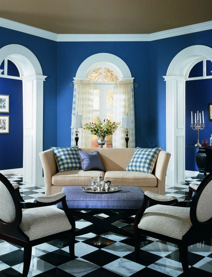 Benjamin moore color blueberry wow with the white trim and black tiled floor this room Black white blue living room