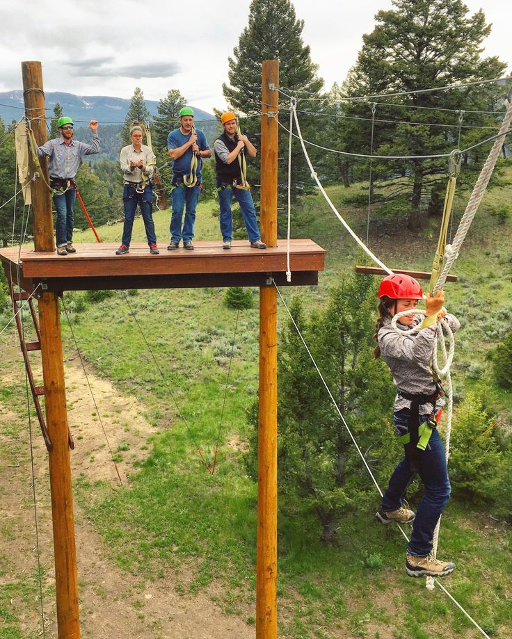 Walking on air in the Montana Rockies. Sometimes you have to break from your normal routine to find what you're truly capable of. The Ranch at Rock Creek's ropes course is a great place to challenge yourself.   Photo by Rancher Lindsay Roberts