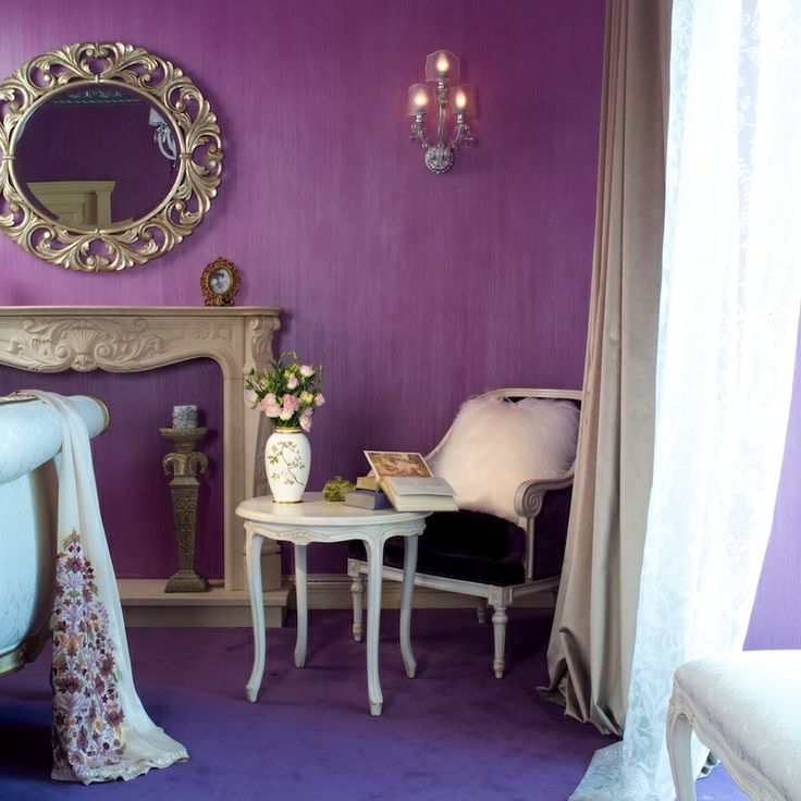 Bright purple interior. Art deco style. Furniture, mirror. Velvet stucco.