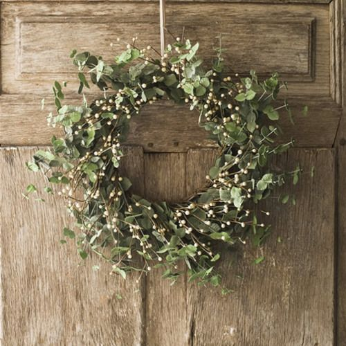 A simple green wreath rings in the holiday season.  #Decorating  #PartyPlanning  #Holiday
