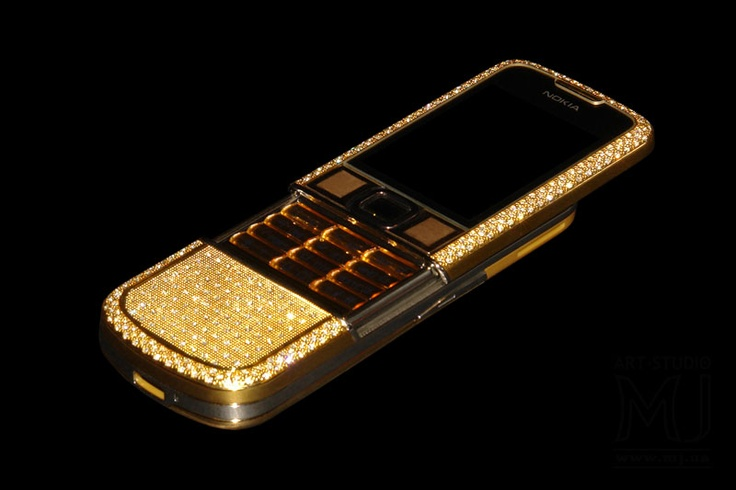 MJ Nokia 8800 Arte Gold Diamond SX7 Edition. Golden phone is decorated by diamonds. The case from cast gold of 585, 750, 777, 888, 999  alloy. Buttons from cast gold. Diamond identifiers. Exclusive boxes. Private Edition.    http://exclusive-mj.com/en/
