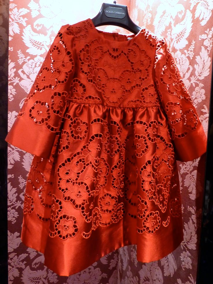 Luxe red silk girls dress with openwork details from Dolce & Gabbana for…