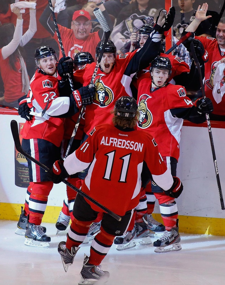 THE WINNERS Ottawa Senators Erik Condra, left, Colin Greening, center, Jean-Gabriel Pageau, right, and Daniel Alfredsson celebrate after Greening scores the winning goal against the Pittsburgh Penguins during the second overtime period of Game 4 of their Stanley Cup Eastern Conference semifinal NHL hockey series at Scotiabank Place in Ottawa on Sunday, May 19, 2013. (AP Photo/The Canadian Press, Patrick Doyle) MORE NHL PLAYOFFS PHOTOS HERE