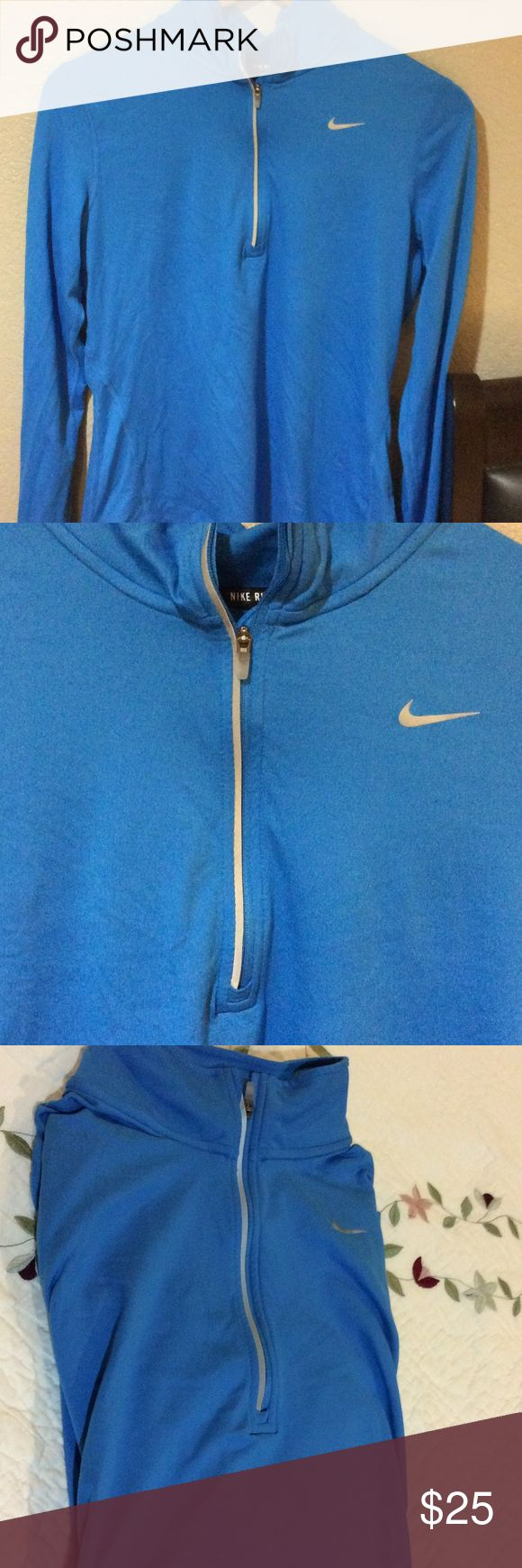Nike Running jacket Never worn blue Nike running jacket.  Super comfy.  Pretty blue, small reflector circles on sleeves.  Holes for thumbs to keep your hands snug while running.  Nike Jackets & Coats