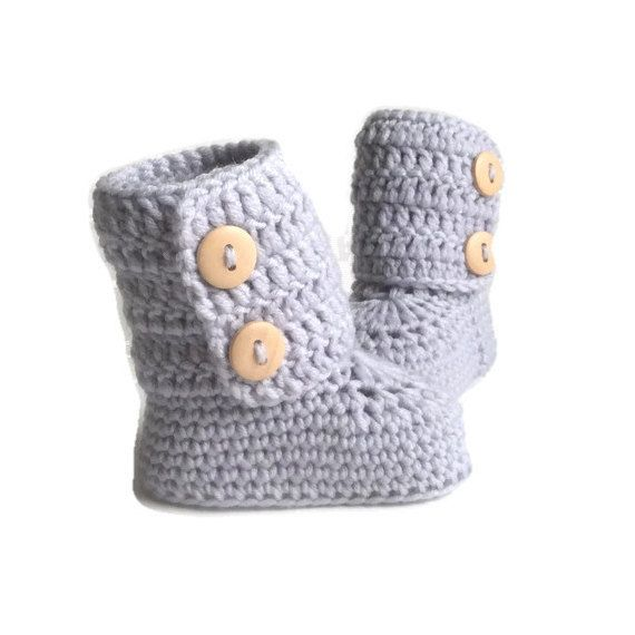 These button cuff baby booties are handmade using soft merino wool. The button cuff opens fully, then wraps around little calves to close. The traditional 10 cm tall design will keep little feet and legs toasty. These booties are a classic tradition with modern style. Their sturdy construction will make them a lasting keepsake and family heirloom. Sizes: 0-6 months ( 9 cm ) (aprox. 10 cm tall)  6-12 months ( 10 cm ) (aprox. 10 cm tall)  Packaging:  These little booties will arrive in a brown…