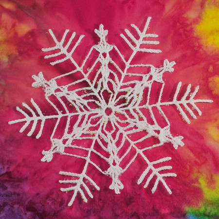 I love this crochet snowflake.... thinking about putting it on my pink cable stitch hat???