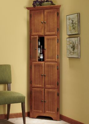 "Make the most of your space by maximizing your corners. Our tall cabinet offers room to hide away canned goods and a host of other items. Sturdy construction with wood frame. Four compartments behind eight doors. Assembly required. Overall, cabinet is 24"" w x 72"" h x 12"" d. Each compartment measures 17"" w x 16"" h x 9"" d."