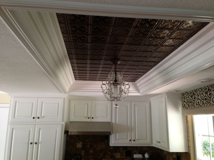 Elegant Kitchen Ceiling Tiles And Hanging Light Replace Dated Fluorescent Lighting.