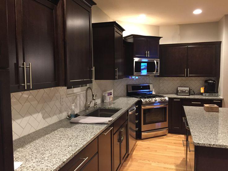 Dark cabinets Kraft maid subway tile azul platino granite