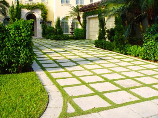 Straight square block pavers for driveway with grass in between