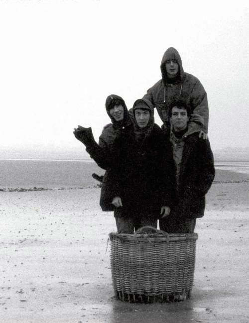 Pink Floyd, floating in a wicker basket, somewhere in rain-soaked England.