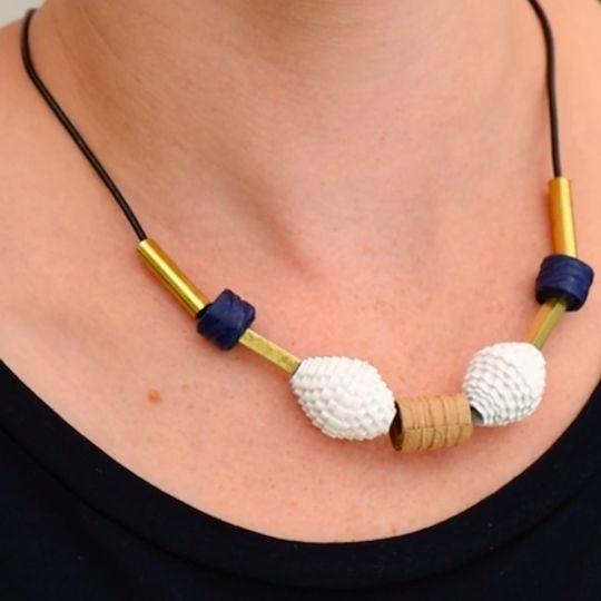 Make beautiful hand-rolled paper beads to create unique statement jewelry from specialty papers and recycled materials.