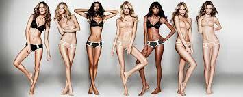 """Victoria's Secret modellen met """"perfecte figuren"""". Veel jongeren (meisjes) willen ook zo een figuur, maar dit is niet realistisch. ( foto )"""