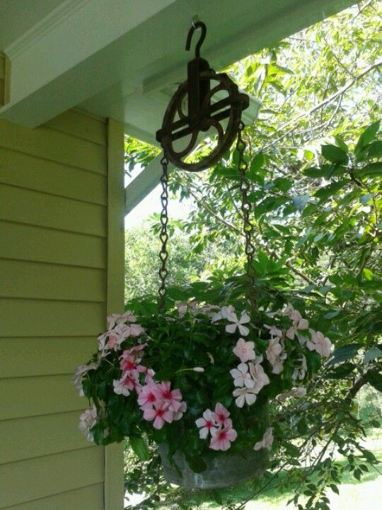 Picked an old well and chain pulley system and created a hanging planter.