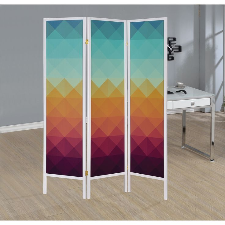 Create private interior spaces in any room of the house with this three-panel folding screen. The multicolored geometric print adds interest to existing home decor. Product Features: Foldable Material
