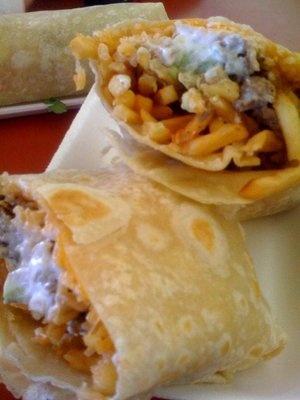 California Burrito: carne asada + fries + sour cream, cheese, guacamole + flour tortilla    Lolita's Taco Shop, San Diego, CA