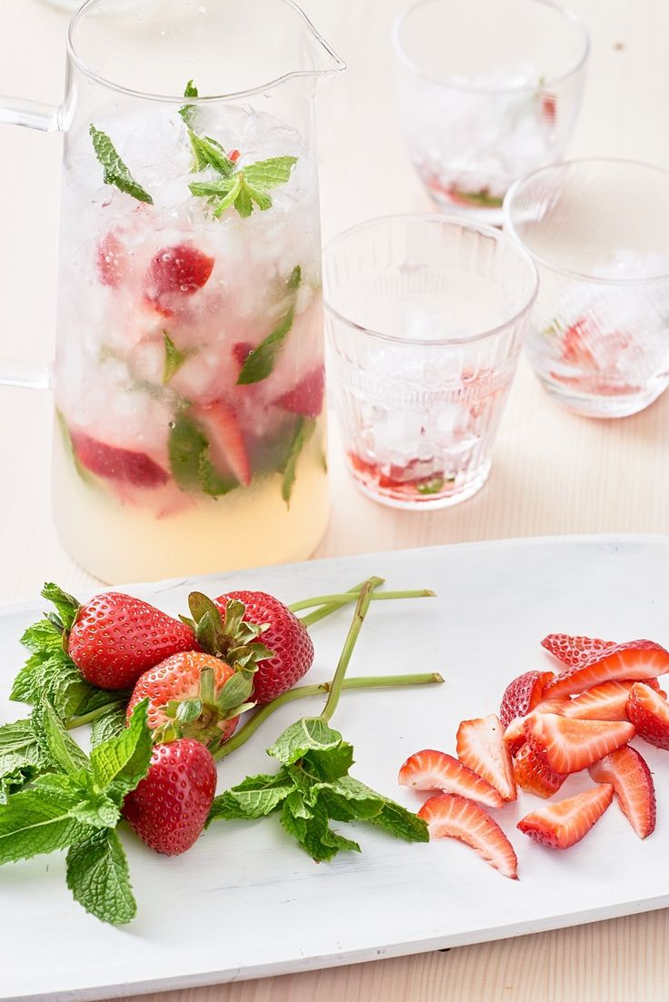 Recipe: Strawberry Mojito Pitcher | Strawberries, on their own, are the taste of summer. Add them to a mojito and you have a berry good drink. The red berries leach their sweetness into the pitcher as they're muddled, acting as the ideal contrast to all that mint and rum. Now, batch that recipe up so that it'll fill your favorite pitcher and you have the makings of a fresh and fruity crowd-pleaser.