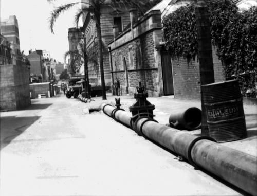 Saltwater pipes installed in Elizabeth Street, Brisbane, 1942. Emergency saltwater fire fighting pipes were installed in Brisbane during World War II for use in case of an air raid.