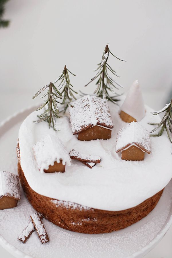 wintery nut cake (gf) with marshmallow frosting and gingerbread houses