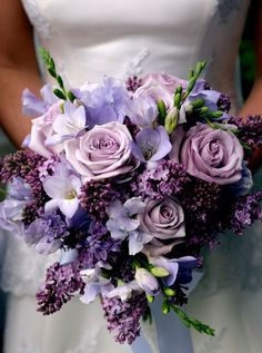 All of the bridesmaids have different shades or purple dresses (plum, wisteria, lapis, and iris). So I like the idea of different shades of purple.