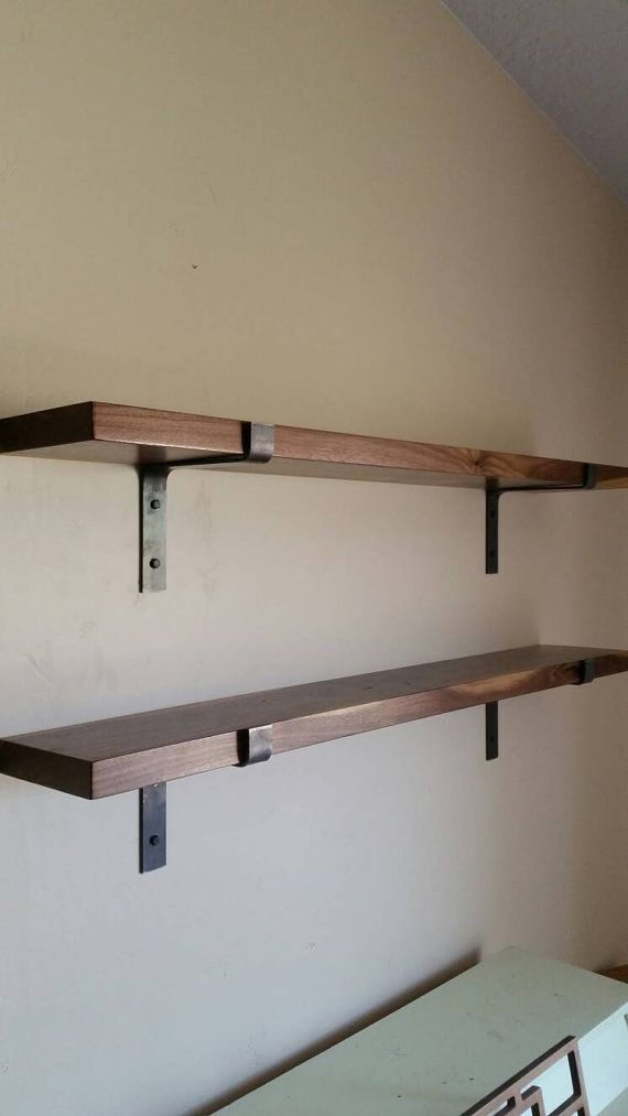 ****FREE SHIPPING ON ORDERS OVER $200****  Add a modern industrial style to any room with these handmade metal shelf brackets. Each bracket is cold bent by me to assure the highest quality possible. This listing is for one shelf bracket. Steel is 1.5 wide x 3/16 thick. All brackets are handmade so there may be very slight variations. The lip of the bracket is 1 3/8 high. Brackets will be left natural unless otherwise specified.  ***LISTING IS FOR 1 BRACKET***  ***HARDWARE NOT INCLUDED…