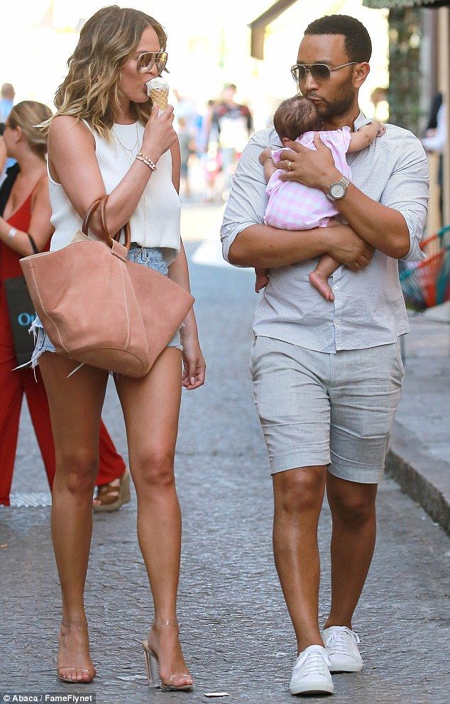 How sweet: Chrissy Teigen and John Legend took a stroll through St. Tropez on Monday with their baby Luna