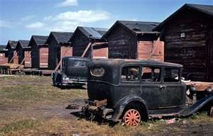 Houses and abandoned cars of migratory workers in Belle Glade, Fla