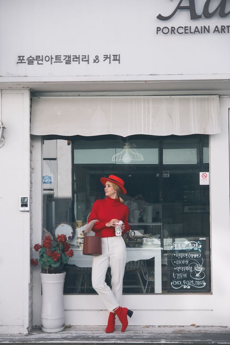 red socks ankle boots red sweater fur strap bag red hat outfit