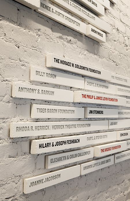 Public Theater lobby / Pentagram (donor recognition signage is dimensional installation. The bigger the gift, the bigger the brick)
