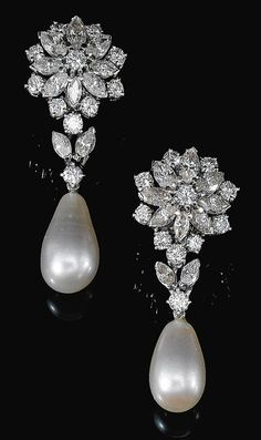 FINE PAIR OF NATURAL PEARL AND DIAMOND EARRINGS, 1960S. Of floral design, each surmount set with marquise-shaped and brilliant-cut diamonds, suspending a drop-shaped natural pearl measuring approximately 10.4 x 10.5 x 17.4mm and 9.75 x 10.0 x 15.8mm respectively, butterfly and post fittings.