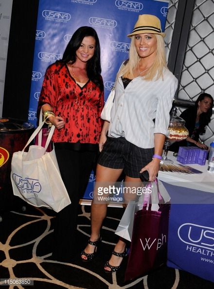 WWE wrestler Candice Michelle (L) and actress Torrie Wilson pose with USANA during Kari Feinstein MTV Movie Awards Style Lounge at W Hollywood on June 2, 2011 in Hollywood, California.