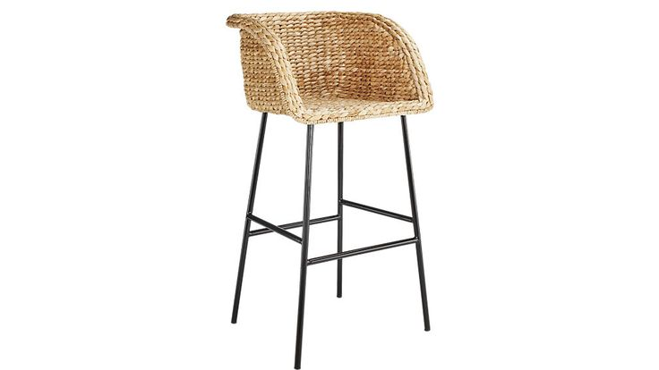 Shop Silas Seagrass Bar Stools.   Natural seagrass forms solid bucket seat that cradles in comfort.  Matte black metal legs stand their ground below.  Silas Seagrass Bar Stools is a CB2 exclusive.