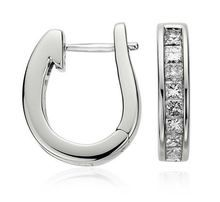 Ve551 Diamond Fashion Earrings Metal: 18k White Gold Length: 5/8 inch Backing: Hinged back Width: 1/8 inch Rhodium Plated: Yes
