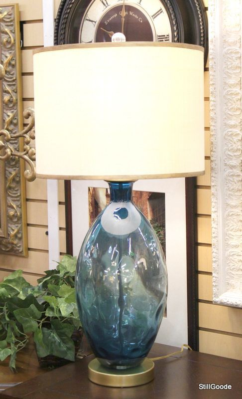 """Beautiful 32"""" tall table lamp by Gallery Design with blue glass base, brass accents, silk shade with gold trim.  Current retail $350. #OnTheShowroomFloor #Gallery #Designer #NEW #StillGoode"""