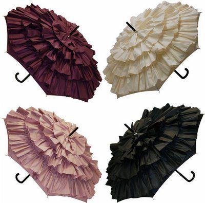 Ruffled Umbrellas. Just cut strips of fabric & make a ruffle with your sewing machine then use a glue gun to glue it down - super cute.