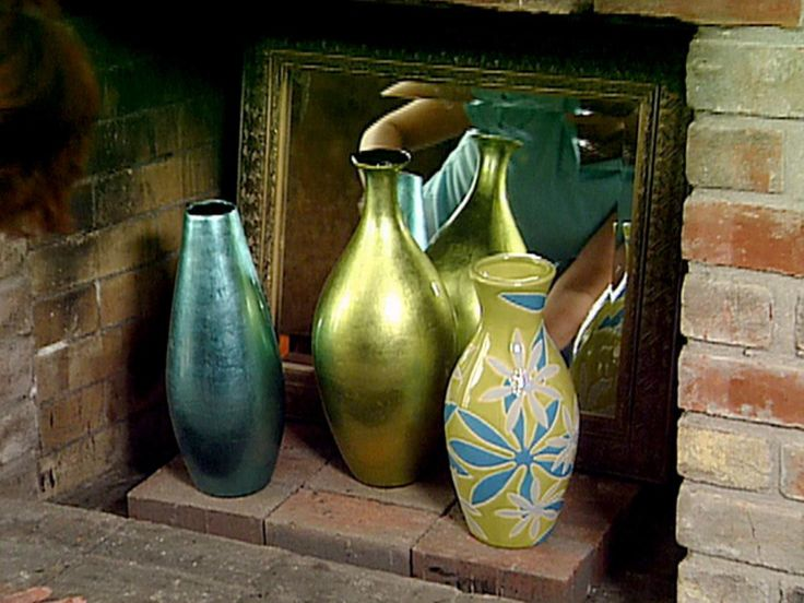 Here's a fun way to cool down your fireplace during the dog days of summer. It's as simple as a mirror and a few of your favorite vases.