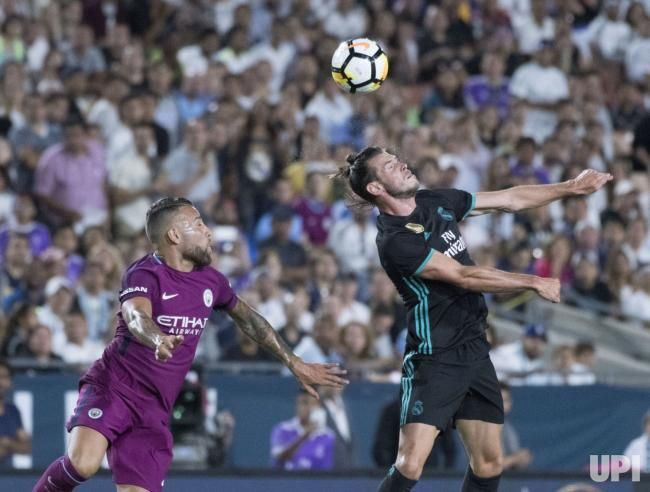Real Madrid's forward Gareth Bale (11) and Manchester City's defender Nicol‡s Otamendi (30) battle near Manchester City's goal in the first…