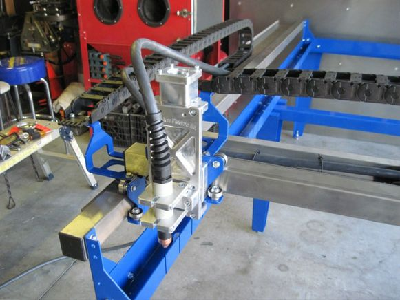 If you have been wondering what it takes to build a CNC Plasma Cutter then get ready to look no further. [Desert Fabworks] has documentedthe trials and tribulations of their CNC Plasma Cutter build....
