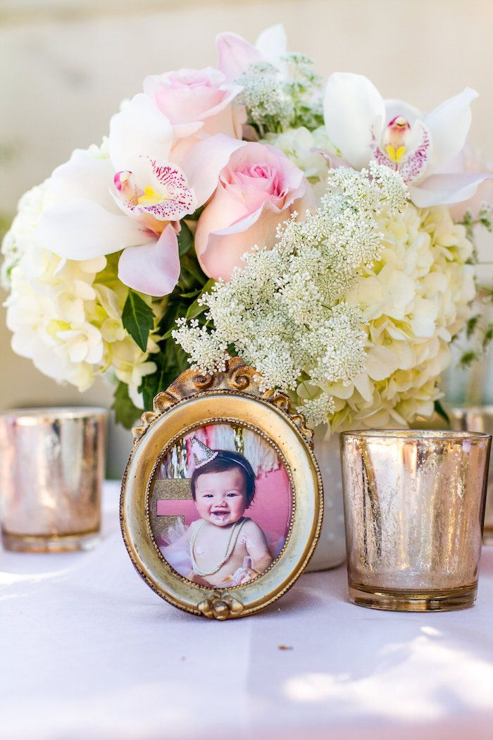 Baby/kid pics around on tables for 60th birthday