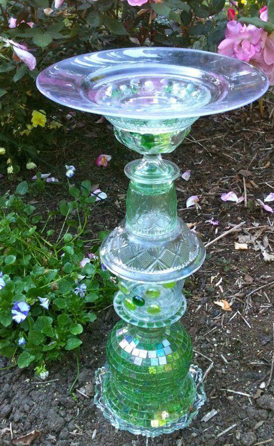 Pretty birdbath from old glass.