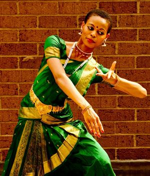Njideka Emenogu was born in Nigeria and came to the United States at the age of nine. She began studying the ancient South Indian dance, Bharatanatyam, in Virginia, where she was raised. When Njideka was 16, she had her first big performance at her Arangetram, or Graduation, where she showed all she had learned in her dance training. Njideka danced beautifully at her Arangetram and was praised in two newspapers: India Abroad and Nigerian Times. Njideka has now lived in New York City for 13…